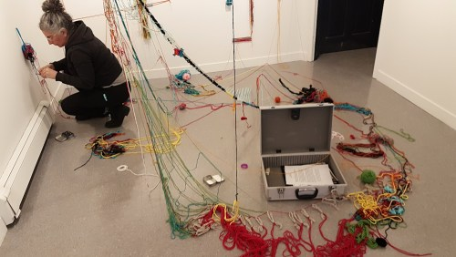 Laura Bucci de-installing inter.action (2019) at Studio Lab Gallery in New Glasgow, NS
