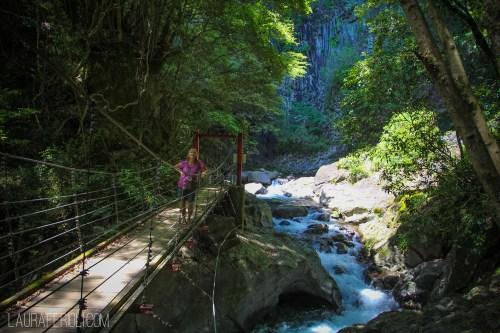 Judy hiking through Kawazu Nanadaru