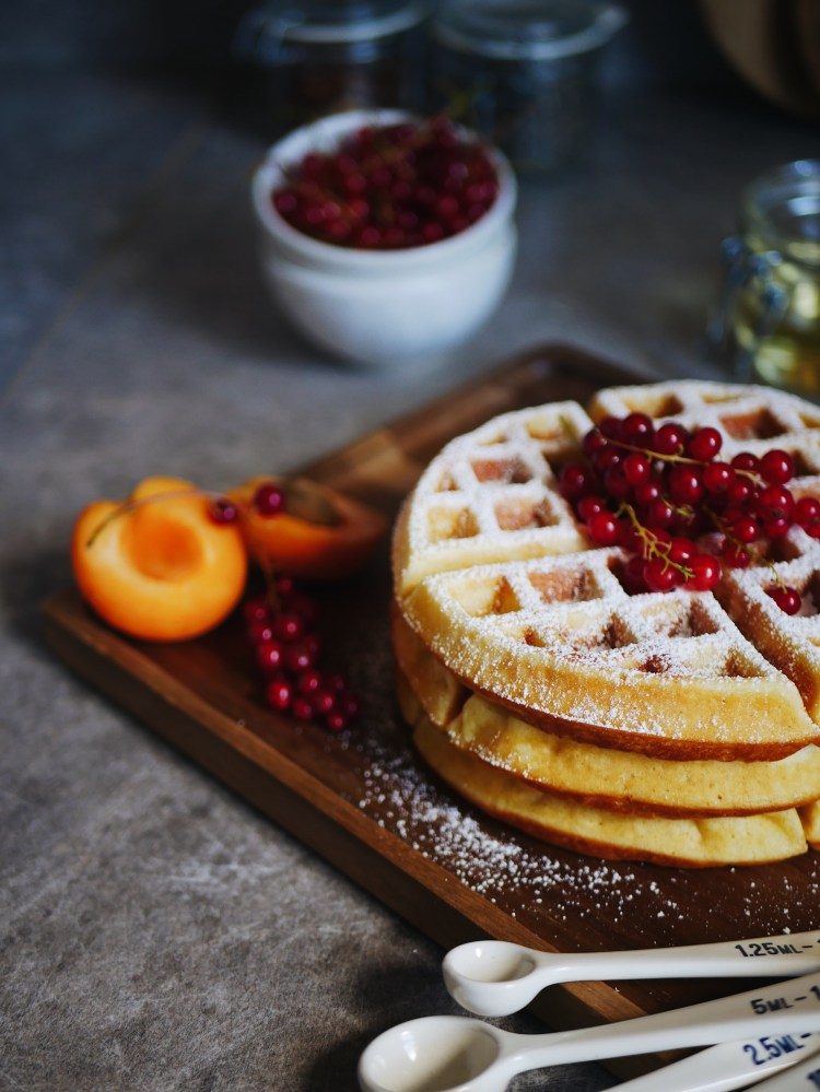 Fluffy Belgian Waffles with Powdered Sugar and Berries