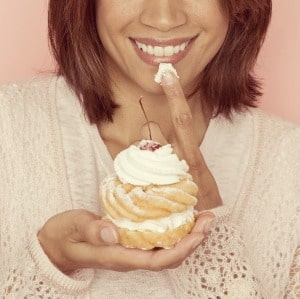 Woman eating sweet donut