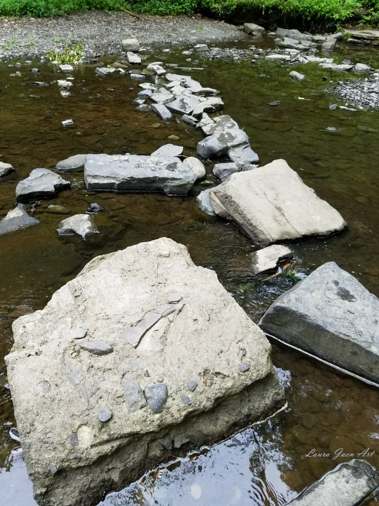 Reference photo for Stepping Stones by Laura Jaen Smith. Photograph of river rocks in creek.