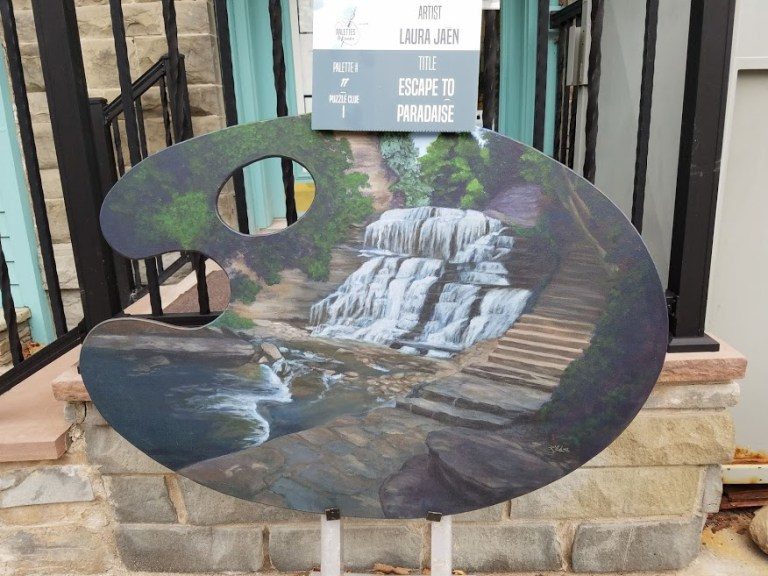 Escape to Paradise by Laura Jaen Smith. Giant palette-shaped painting of waterfall in Cascadilla Gorge Ithaca New York