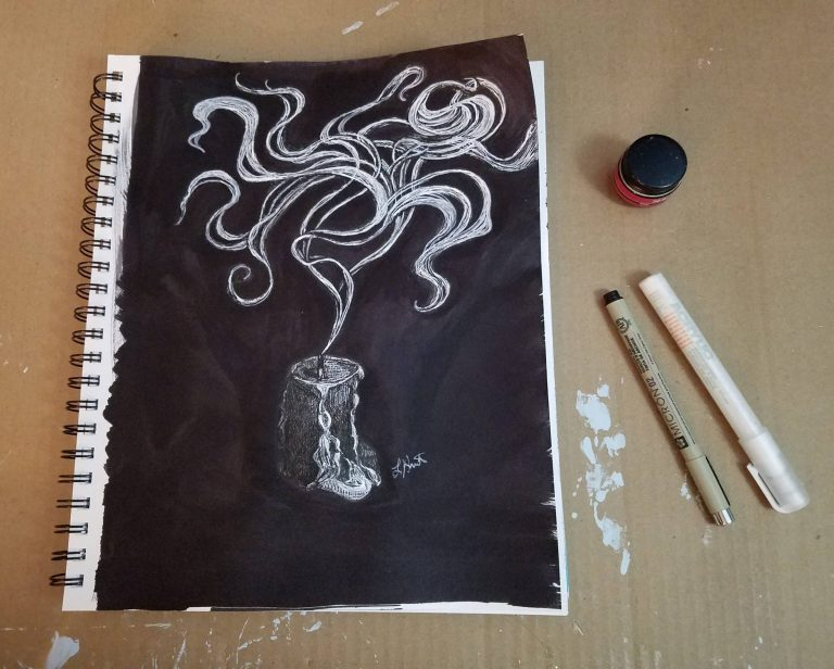 Sketchbook view with pens and fluid ink of Extinguished Candle by Laura Jaen Smith. Black and white ink drawing of candle in the dark being extinguished with wisps of smoke swirling.