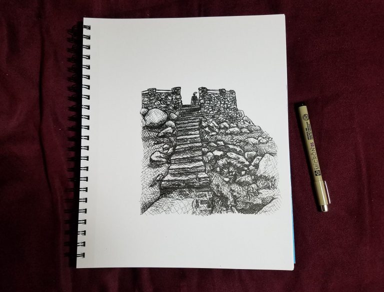 Sketchbook view with pen of Wyoming Tower by Laura Jaen Smith. Black and white ink drawing of observation tower in Medicine Bow National Forest in Laramie WY