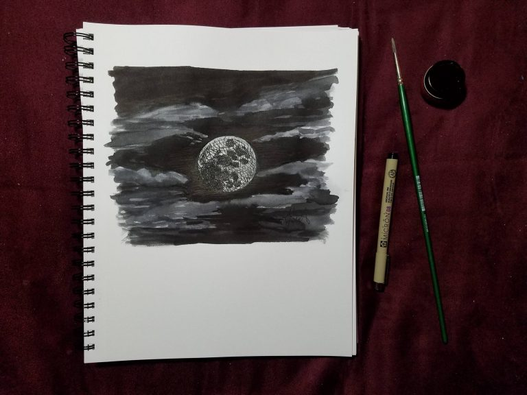 Sketchbook view of Fully Moon ink drawing by Laura Jaen Smith with pen, brush, and liquid ink.