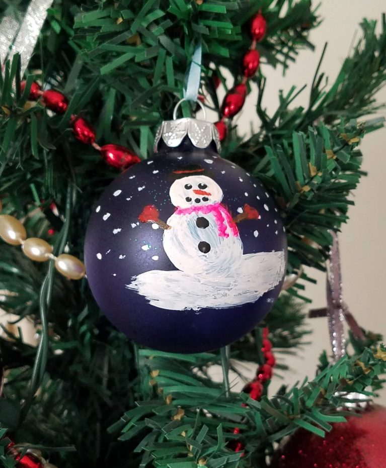 Blue ornament with hand-painted snowperson