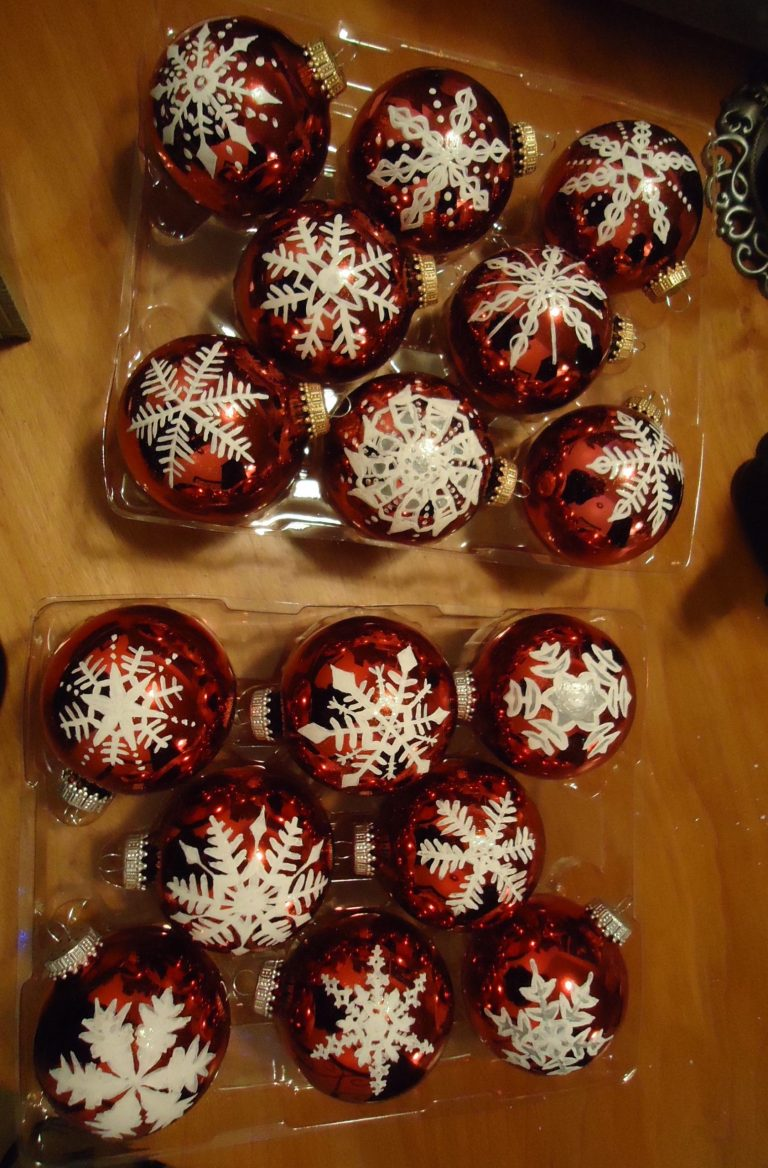 16 red ornaments with hand-painted white snowflake