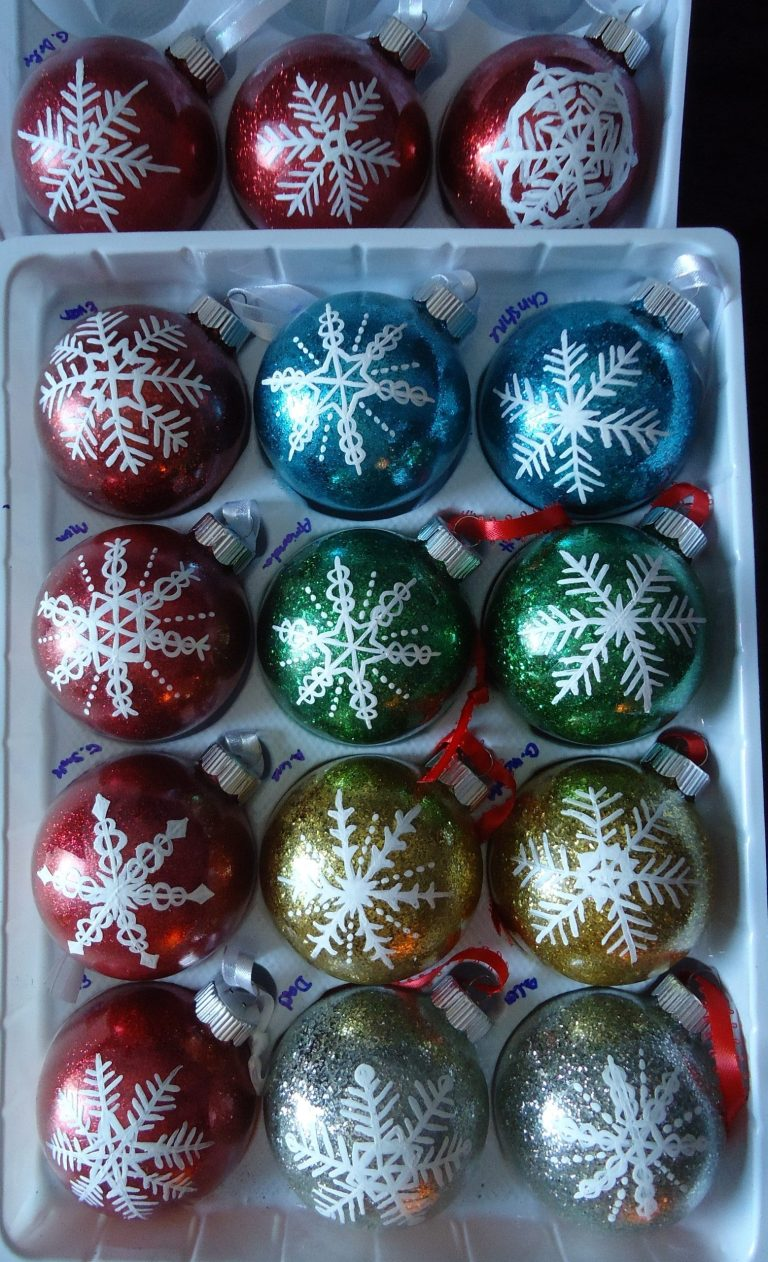 15 different glitter colors of ornaments with white hand-painted snowflake