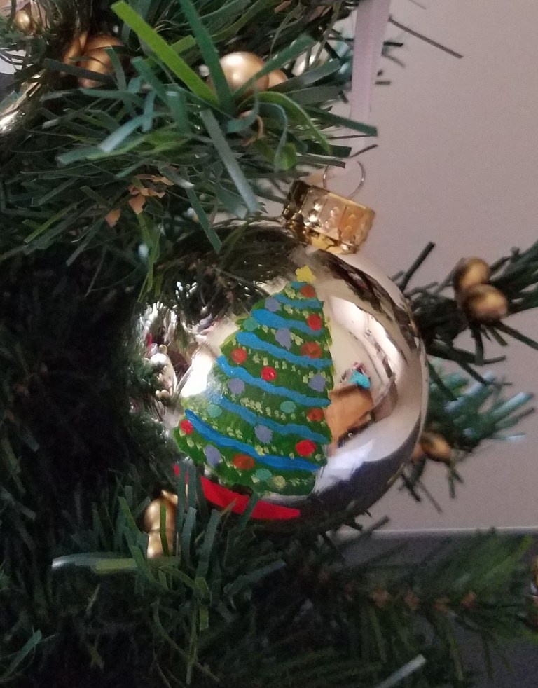 Gold ornament with tree hand-painted