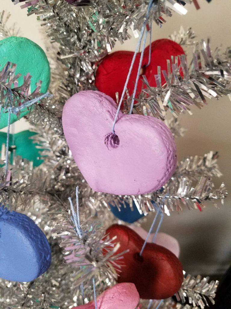 Close up of light purple valentine heart ornament on silver tree