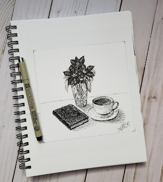 Inktober day 1 ink drawing challenge. Table with book, cup of tea and saucer, and crystal vase with clematis.