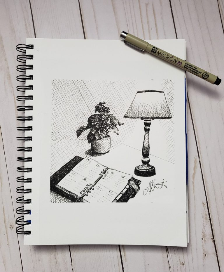 Inktober day 9 ink drawing challenge. Table with lit lamp, open day planner, and pot of african violets.