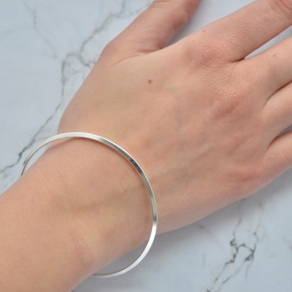 Triangular solid silver handmade ladies bangle by Laura Llewellyn Design