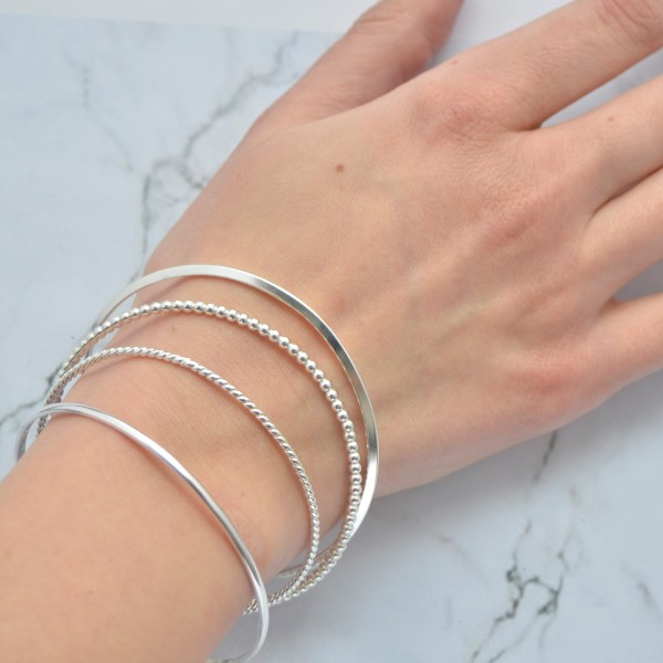 Solid silver stacking bangles by Laura Llewellyn Design