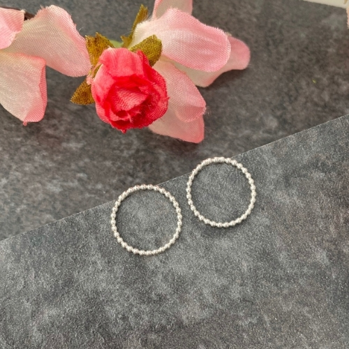 Small silver circle stud earrings