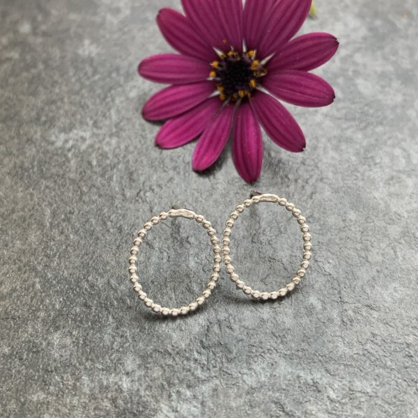 Small oval silver stud earrings