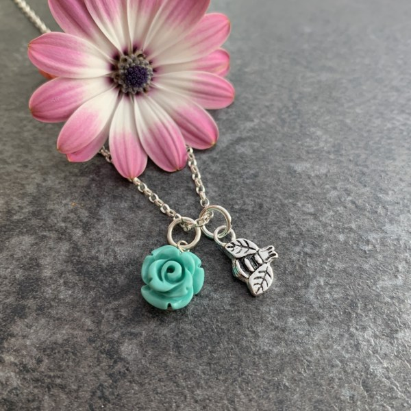 Bee and green flower pendant