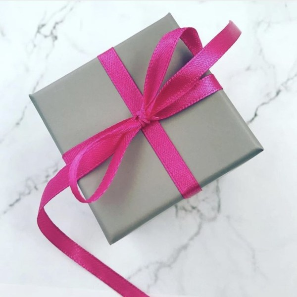 Gift box tied with a pink ribbon