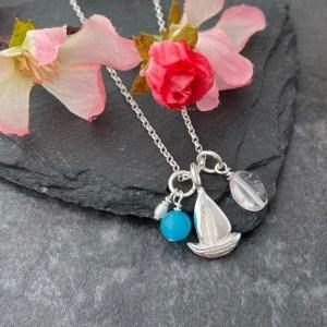 Silver sailboat charm pendant