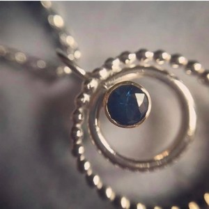 Silver and gold sapphire pendant