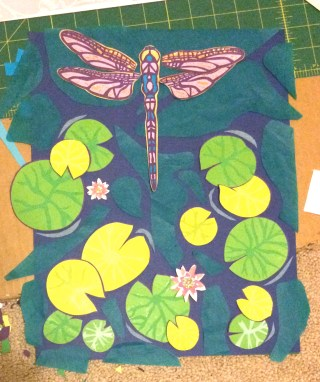 Many more hours of work and it is almost done.  I decided to do a combination of lilac and sparkly gold under the wings, blue paper in parts of the body.  Details have been added to all the lily pads.  Note when using tissue paper (the blue/green in the water) it looks much different before it's glued.