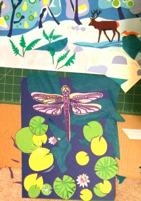 A lot of extra detail was added here - darker paper under the lily pads, for example.  At this point I was undecided about whether I should do the solid gold, the lilac, the sparkly gold, or a combination, under the wings.