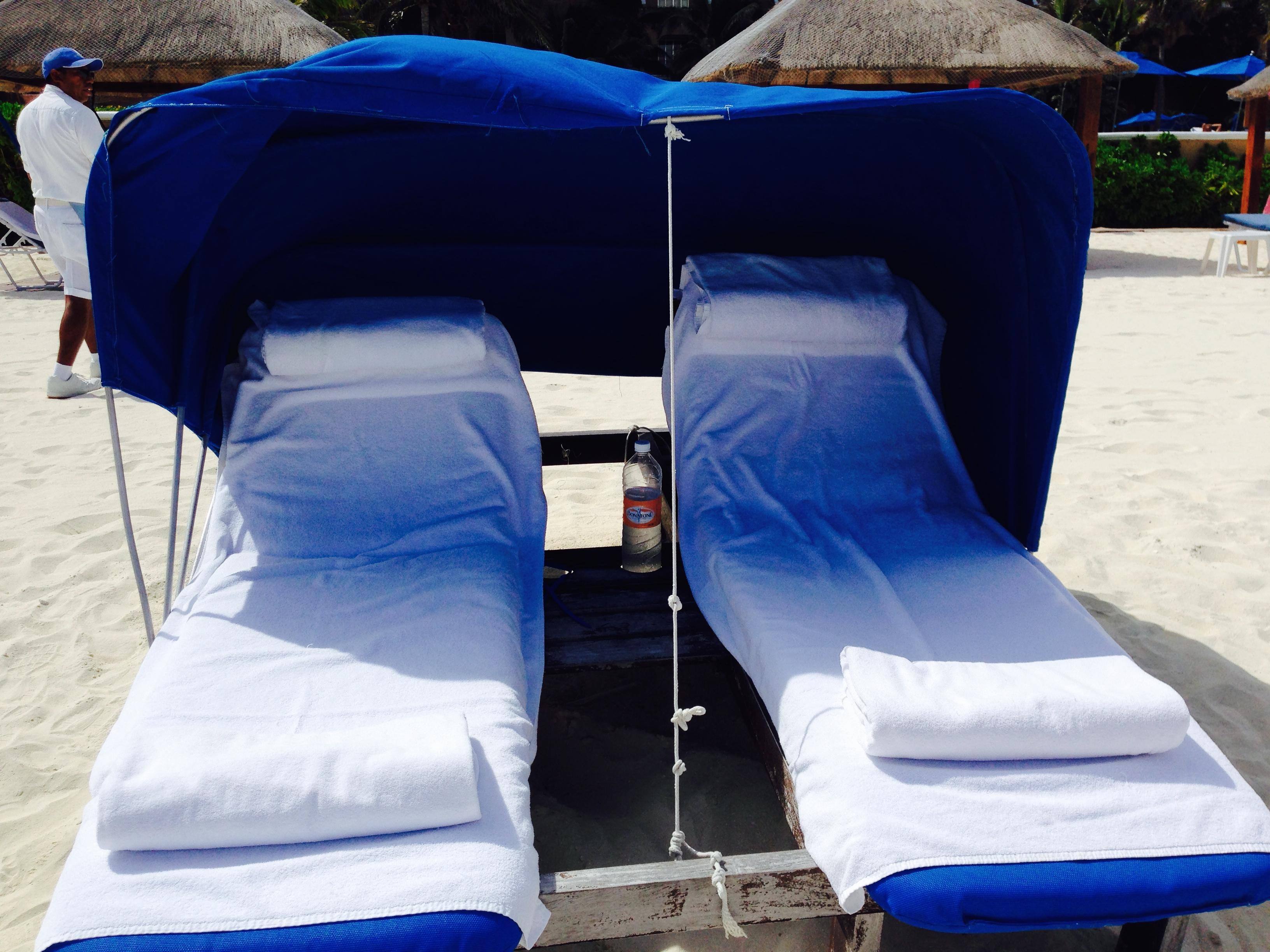 Plenty of covered serviced beach palapas