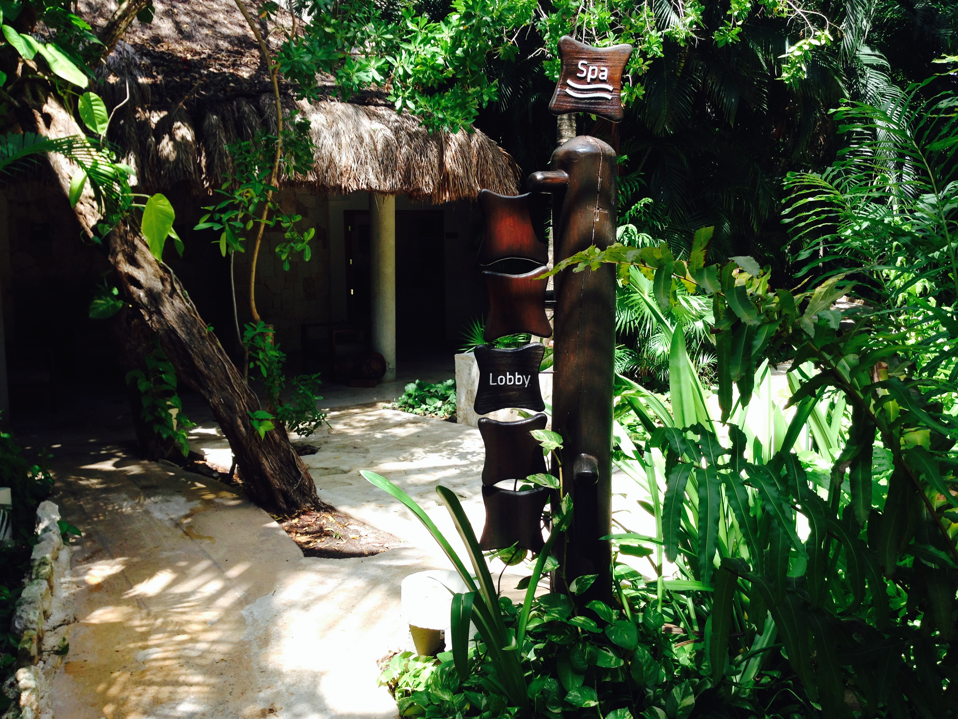 There is no traditional lobby at Viceroy and the signage along the jungle-like pathways lets you know if you are heading to the beach or the spa.