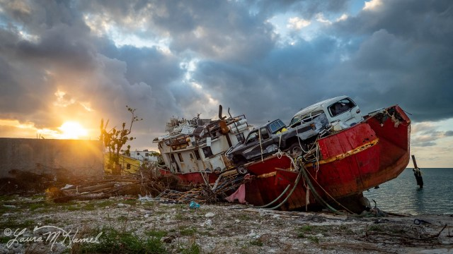 Destroyed boat with vehicles in Marsh Harbour, Abaco, The Bahamas. Hurricane Dorian Relief 2019. OpenWorld Relief/Laura M. Hamel