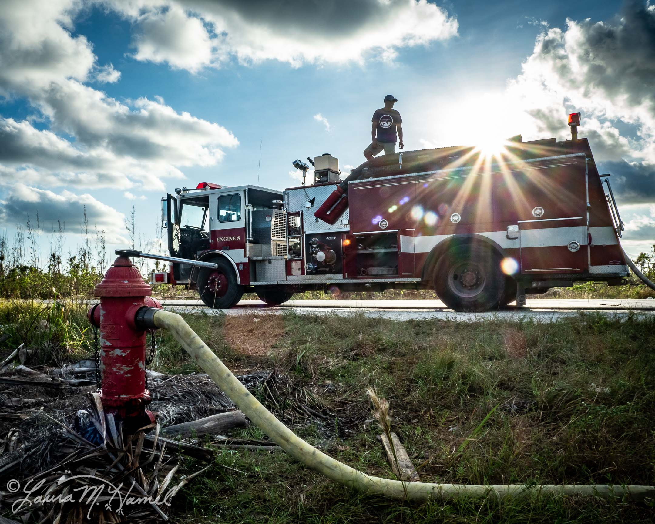 OpenWorld Relief volunteers helping the Marsh Harbour Volunteer Fire Department with cleanup of Engine 8 by taking it to a hydrant to be flushed out. Marsh Harbour, Abaco, The Bahamas. Hurricane Dorian Relief 2019. OpenWorld Relief/Laura M. Hamel