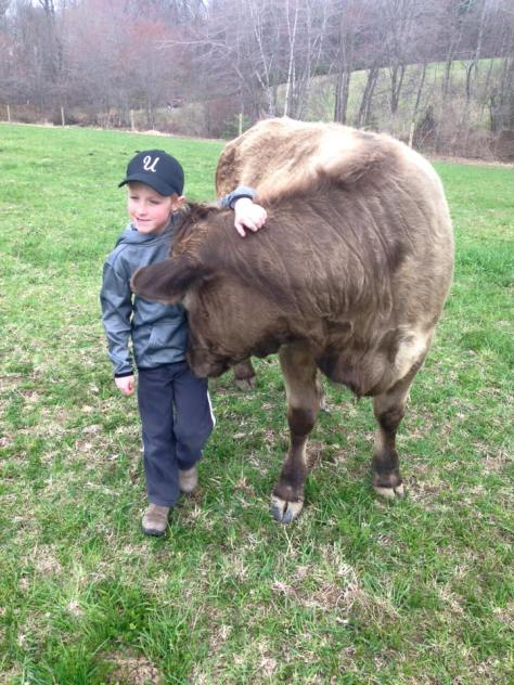 Caleb with Agape. Photo courtesy of Town Line Dairy in Upton.