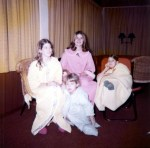 Laura (sitting on the floor) with her bossy big sisters, Patty, Gail, and Janet
