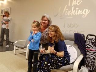 Laura signing books