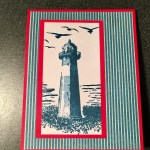 High Tide lighthouse pop up card front created with real red and tranquil blues