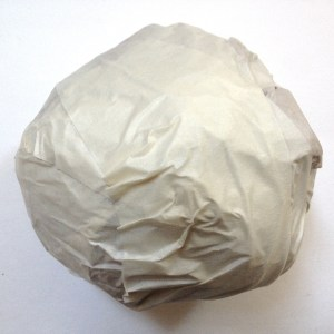 Then, wrap tape around it. A white cabbage!