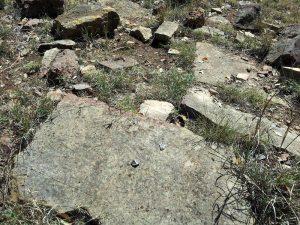 a broken arrowhead on a Kincheloe hearthstone