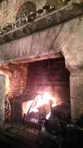 fire in enormous stone fireplace