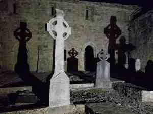 Cong Abbey by night, Celtic crosses and graves