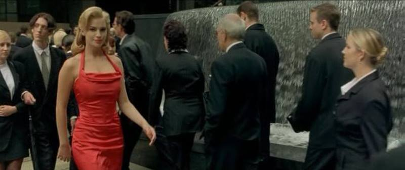 crowd of business people and the woman in the red dress, from the Matrix