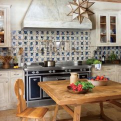 French Country Kitchens Wood And Stainless Steel Kitchen Island He Loves The Phony Laurel Home Photo Oberto Gili Peregalli Saint Moritz Switzerland