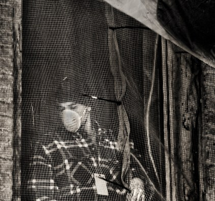 Masked Worker in Netting