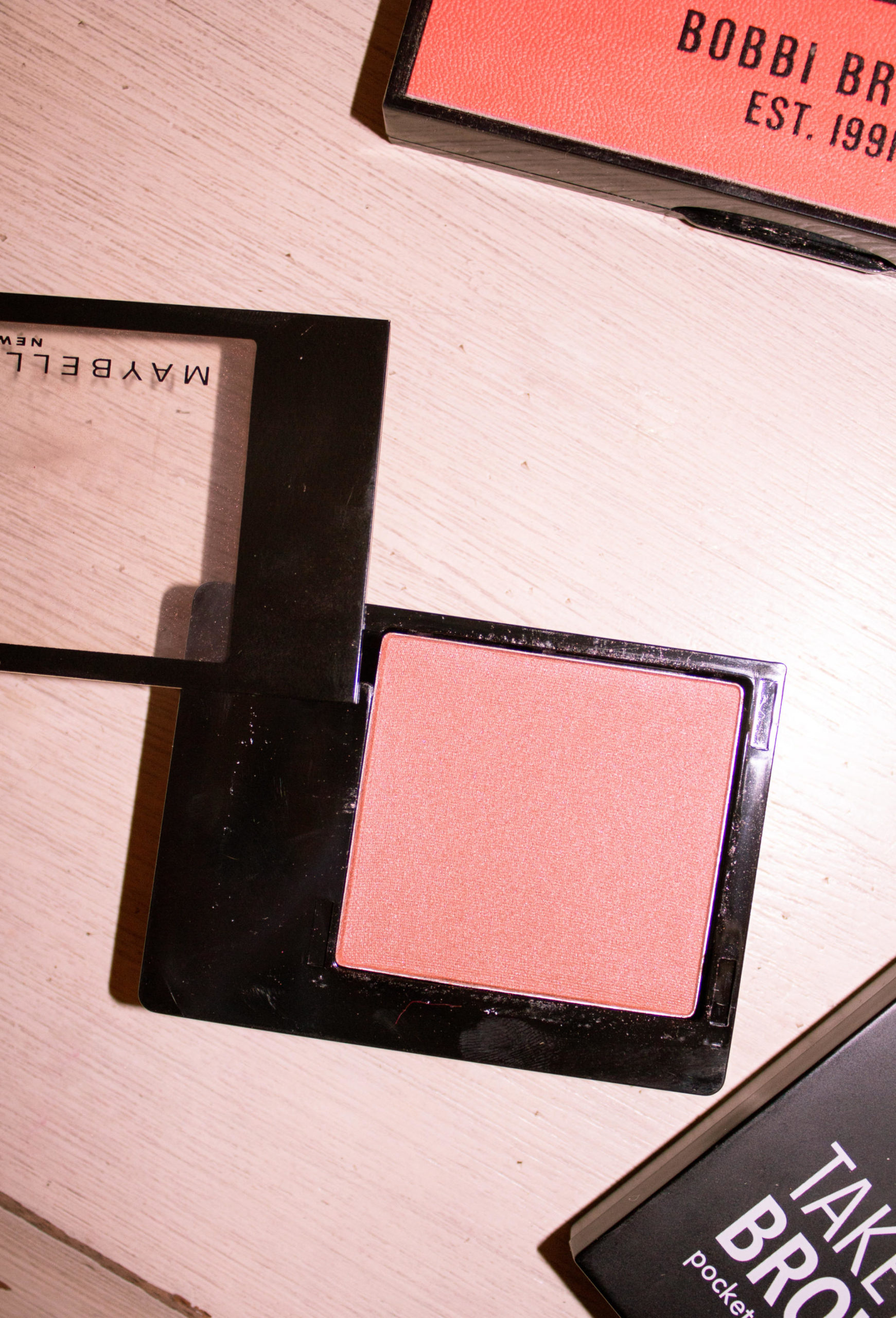 pink blush make-up on table