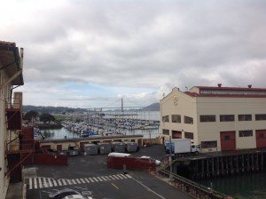 Fort Mason buildings with the marina and the iconic bridge in the background