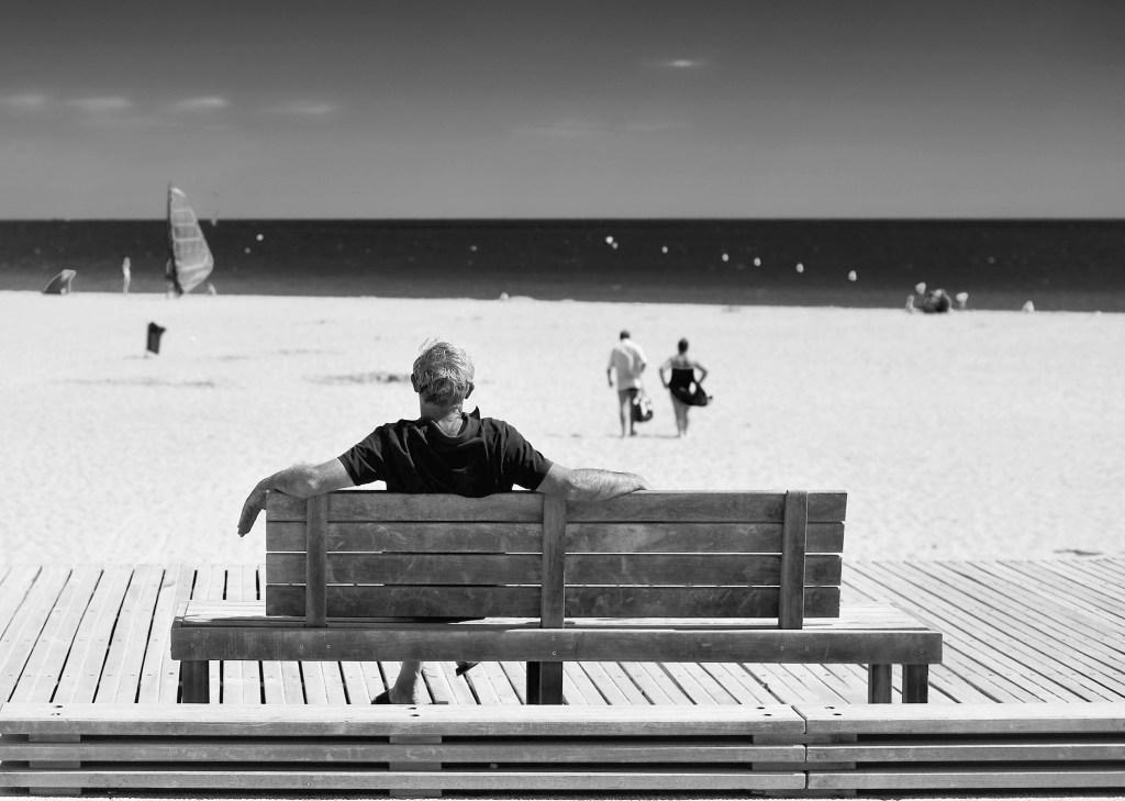 Man on a beach bench, France