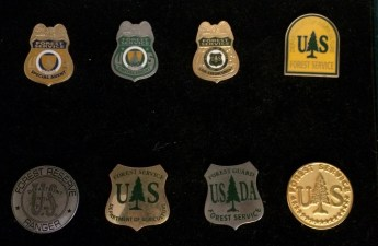 Forest Service badges in Grey Towers library