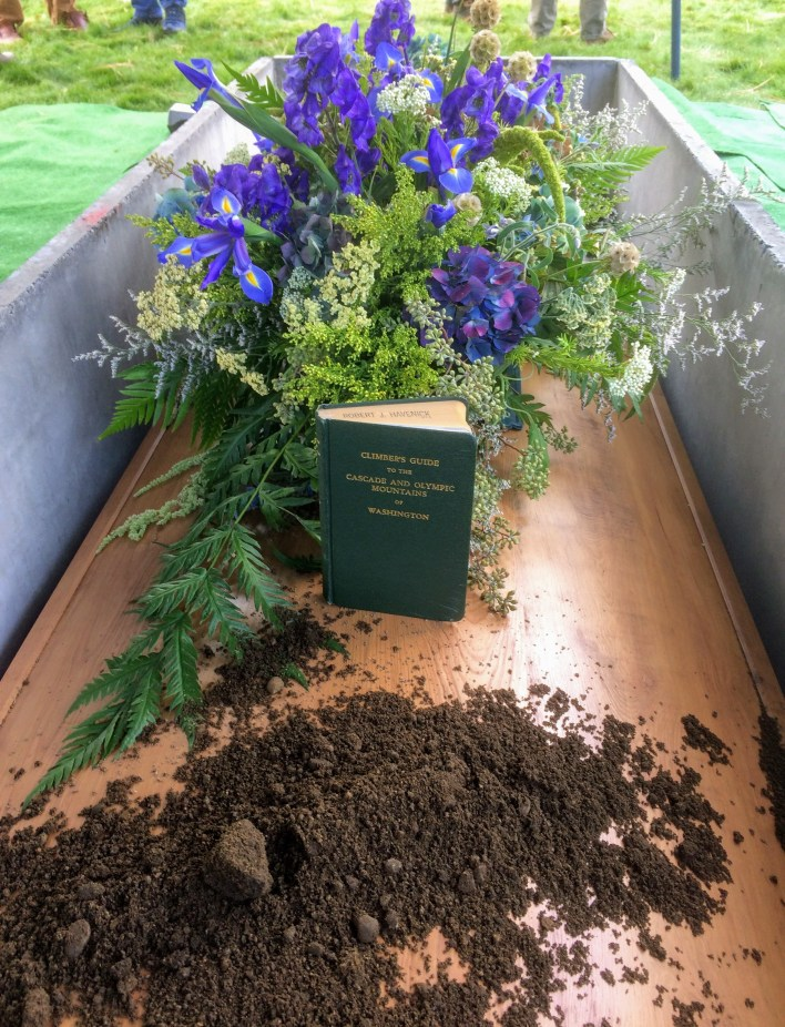 Irises, hydrangeas, and a final bit of dirt for the original dirtbag--and a copy of one of his highly regarded books, <em>Climber's Guide to the Cascade and Olympic Mountains of Washington</em>, first published by the American Alpine Club in 1949.