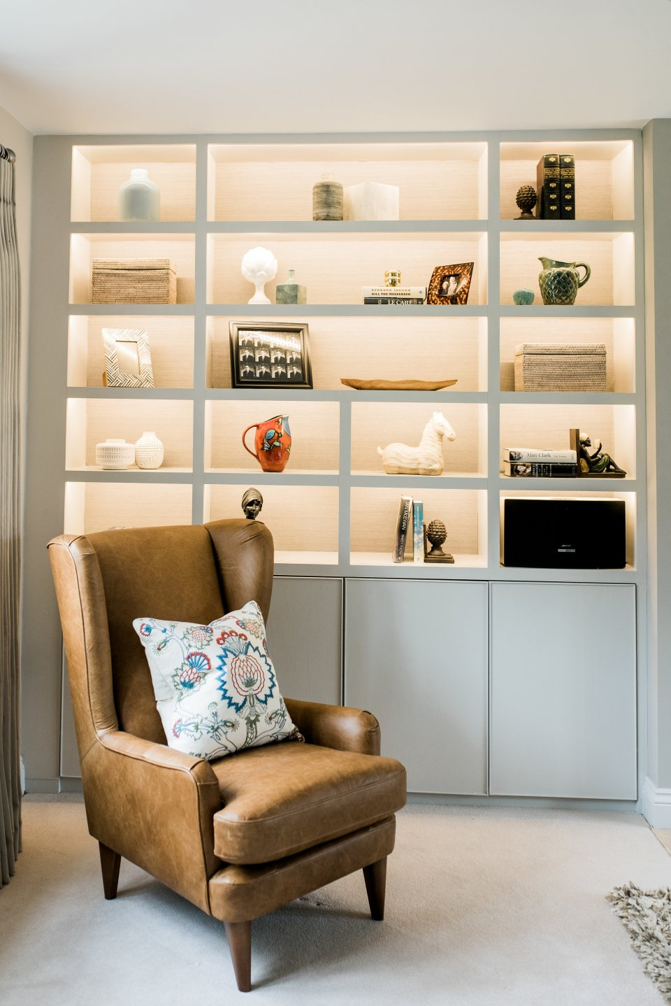 Shelving styling in modern Cotswolds home spring cleaning