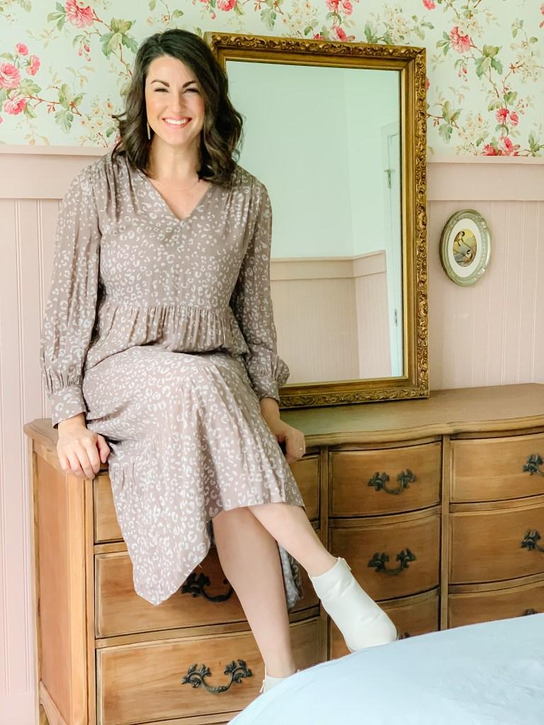 Woman sitting on refinished vintage dresser