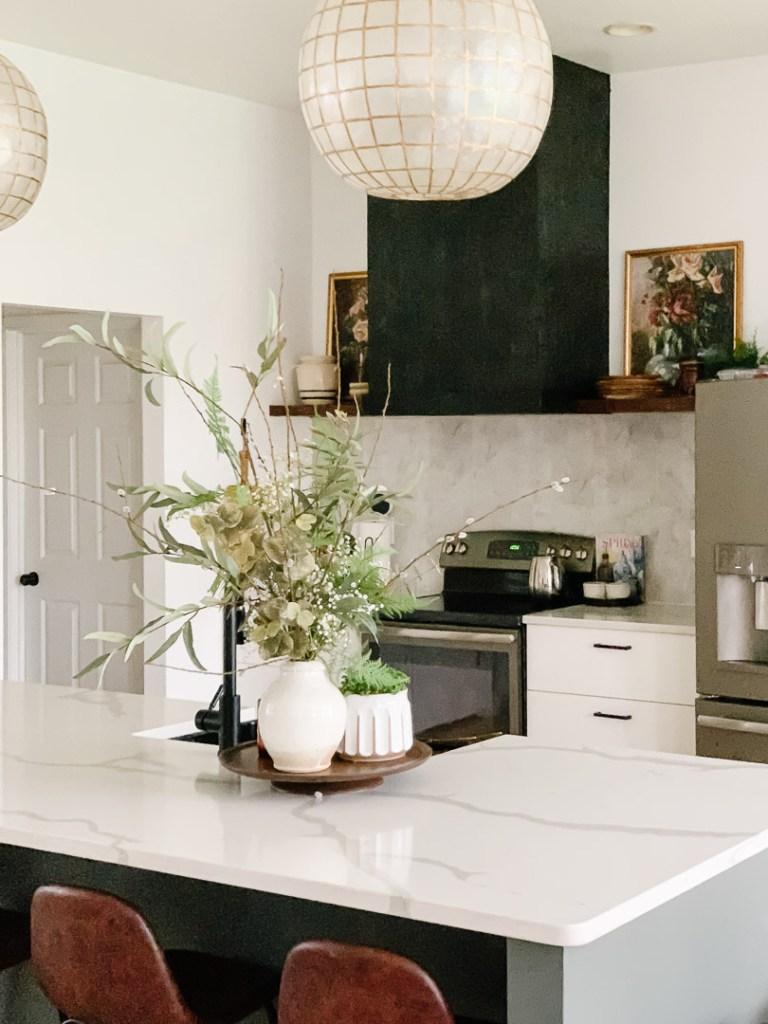 The Lauren Jamison Collective Kitchen Remodel. Black Shiplap DIY Vent Hood, Calcutta quartz kitchen countertops, open shelves, diy faux florals.
