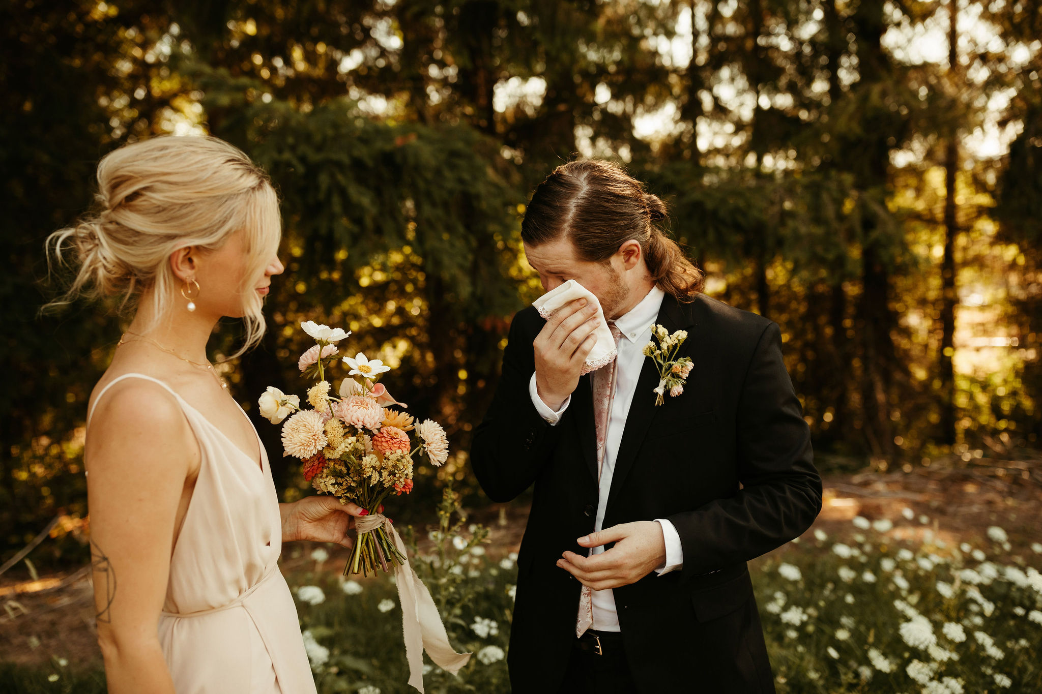 groom crying after first look
